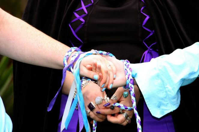 Handfasting ribbons created by me, featuring our wedding colours and crystals and charms with meaning to us and our relationship.